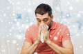 Sick Man Blowing Nose To Paper Napkin At Home Stock Photography - 79851292