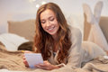 Happy Young Woman With Notebook In Bed At Home Stock Photo - 79852880