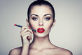 Beautiful Woman Paints Lips With Lipstick Stock Photos - 79853713