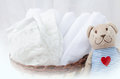 Set Of Diapers For Newborn In Basket With Love Bear Toy. Baby Cl Stock Photo - 79890080