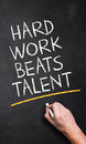 Hand Writing  Hard Work Beats Talent  Stock Images - 79948544