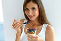 Healthy Breakfast. Woman With Glass Of Yogurt, Berries And Oats Royalty Free Stock Photos - 79973118