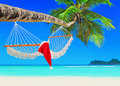 Red Santa Claus Hat On Hammock At Palm Island Beach Stock Image - 80020101