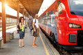 A Couple Of Backpacker Tourists Waiting To Board A Train Stock Photos - 80026743