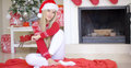 Beautiful Sexy Girl Sitting On The Floor Next To Christmas Tree Stock Image - 80032701
