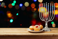Hanukkah Holiday Sufganiyot With Menorah On Wooden Table Royalty Free Stock Photo - 80034575