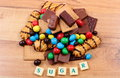 A Lot Of Sweets With Word Sugar On Wooden Surface, Unhealthy Food Royalty Free Stock Photography - 80057547