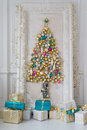 Beautiful Interior Living Room Decorated For Christmas. Big Mirror Frame With A Tree Made Of Balls And Toys Royalty Free Stock Photo - 80072865