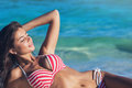 Woman Laying By Sea Royalty Free Stock Photo - 80076735