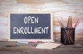 Open Enrollment Text On A Blackboard. Old Wooden Table With Text Stock Photography - 80080112