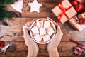 Creative Hobby. Woman S Hands Show Mug Of Cocoa With Marshmallows, Christmas Holiday Handmade Tree Toy And Scissors On Royalty Free Stock Images - 80096519