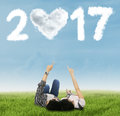 Couple Pointing Number 2017 On Meadow Royalty Free Stock Images - 80099419