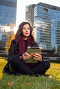 Asian Woman Holding Tablet In Hand, Sitting Instanding Outdoors Behind Skyscrapers Royalty Free Stock Photo - 80113605
