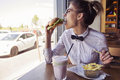 Beautiful Caucasian Young Woman Eating Lunch Fast Food Fried Pot Royalty Free Stock Photo - 80133845