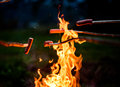 Making And Cooking Hot Dog Sausages Over Open Camp Fire. Stock Photo - 80139620
