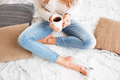 Woman Holding Tea Cup While Sitting With Legs Crossed Stock Image - 80141971