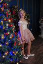 Girl In A Smart Pink Dress In The Christmas Royalty Free Stock Images - 80147129