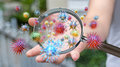 Close Up On A Sick Man Hand Through Magnifying Glass Transmittin Royalty Free Stock Images - 80162929