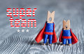 Super Team Concept. Clothespin Peg Superheroes In Blue Suit And Red Cape. Gray Wood Abstract Design Background. Macro Royalty Free Stock Photos - 80166728
