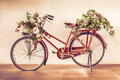 Vintage Style Of Red Bicycle With Flower Baskets Parking Against Stock Photos - 80172173