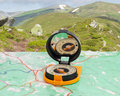 Magnetic Compass On Tourist Map On Background Of Mountain Range Royalty Free Stock Images - 80187969