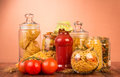 Various Shapes Pasta In Jars, Bottle Ketchup, Tomato On Brown. Royalty Free Stock Image - 80208606