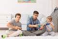 Brothers Playing Video Games Royalty Free Stock Photos - 80209708