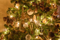 Christmas Tree Decorated Gingerbread, Cinnamon And Ball Close-up. Light From The Garlands Royalty Free Stock Images - 80229859