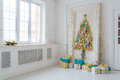 Beautiful Interior Living Room Decorated For Christmas. Big Mirror Frame With A Tree Made Of Balls And Toys Royalty Free Stock Images - 80243039