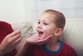 Boy With Symptoms Hand, Foot And Mouth Disease Taking Syrup Royalty Free Stock Photo - 80247675