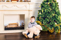 Boy Sits With Teddy Bear In The Background Of The Christmas Tree. Stock Image - 80254071