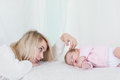 Mother Puts Her Baby Daughter To Sleep Royalty Free Stock Photo - 80272645