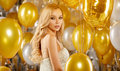 Portrait Of Blond Young Woman Between Golden Balloons And Ribbon Royalty Free Stock Photos - 80290618