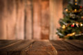 Old Wood Table Top With Blur Christmas Tree In Background Royalty Free Stock Image - 80303996