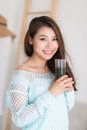 Smiling Young Asian Woman Drinking Green Fresh Vegetable Juice O Royalty Free Stock Photos - 80309878