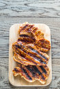 Grilled Pork Steaks On The Wooden Board Stock Photos - 80341653