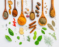 Various Herbs And Spices In Wooden Spoons. Flat Lay Of Spices In Royalty Free Stock Image - 80365156