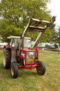 Old Red Tractor With Lifting Equipment Stock Image - 80375291