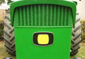 Close-up Of Front Part Of A Green Tractor Royalty Free Stock Photo - 80375345