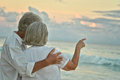 Elderly Couple Rest At Tropical Beach Stock Photo - 80378350