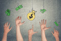 Hands In Air Tryong To Reach Banknotes And Money Bag, Hanging On Hooks Royalty Free Stock Images - 80420039