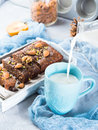 Pouring Milk In Blue Mug For Breakfast With Cake. Vertical Royalty Free Stock Photography - 80423467