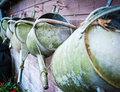 A Row Of Well Used Watering Cans Hang On A Shed Wall Stock Photo - 80426330