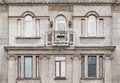 Windows And Balcony On Facade Of Apartment Building Stock Photography - 80437622
