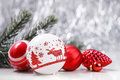 White And Red Christmas Ornaments And Fir Tree Branch On Glitter Bokeh Background With Space For Text. Xmas And Happy New Year Royalty Free Stock Photos - 80452698