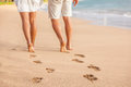 Beach Couple Walking Barefoot On Sand - Footprints Royalty Free Stock Photography - 80457847