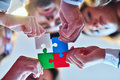 Business People Group Assembling Jigsaw Puzzle And Represent Team Support Royalty Free Stock Photos - 80461608