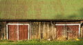 Red Barn Doors On An Old Shed With A Green Roof Royalty Free Stock Photos - 80467018