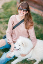 Young Stylish Hipster Woman Girl Playing White Kid-skin Dog In Country Side Royalty Free Stock Photos - 80467138