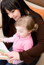 Mother Reading Book Royalty Free Stock Photos - 8058398
